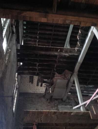 Photo showing the inside of the former Union Steam Ship Company Store before the restoration.